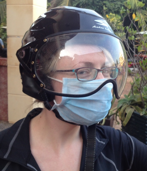 BK-C prepares to operate. Everywhere in SE Asia, people wear surgical masks. Mostly to protect them from the dust or smog when they're riding their mopeds - or in Vietnam, where there's a big line in leopard print surgical masks, just for fashion.
