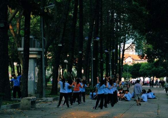 School children practice badminton in a park in HCMC. Badminton is big out here - it's common for courts to be marked on the streets. Perhaps the absence of mopeds driving across the court at the 2012 Olympics is why Vietnam's one Olympian badminton player failed to advance past the elimination rounds.